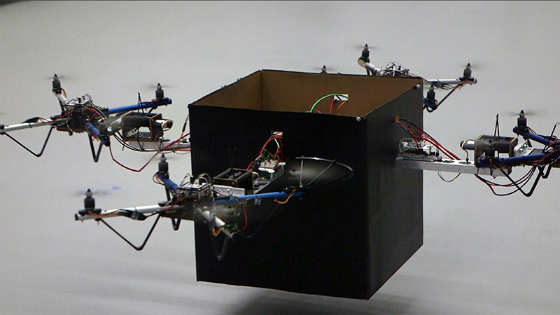 Researchers have developed a modular solution for handling larger packages without the need for a complex fleet of drones of varying sizes. By allowing teams of small drones to collaboratively lift objects using an adaptive control algorithm, the strategy could allow a wide range of packages to be delivered using a combination of several standard-sized vehicles. (Credit: John Toon, Georgia Tech)