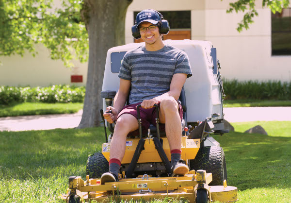 Student works on the grounds crew