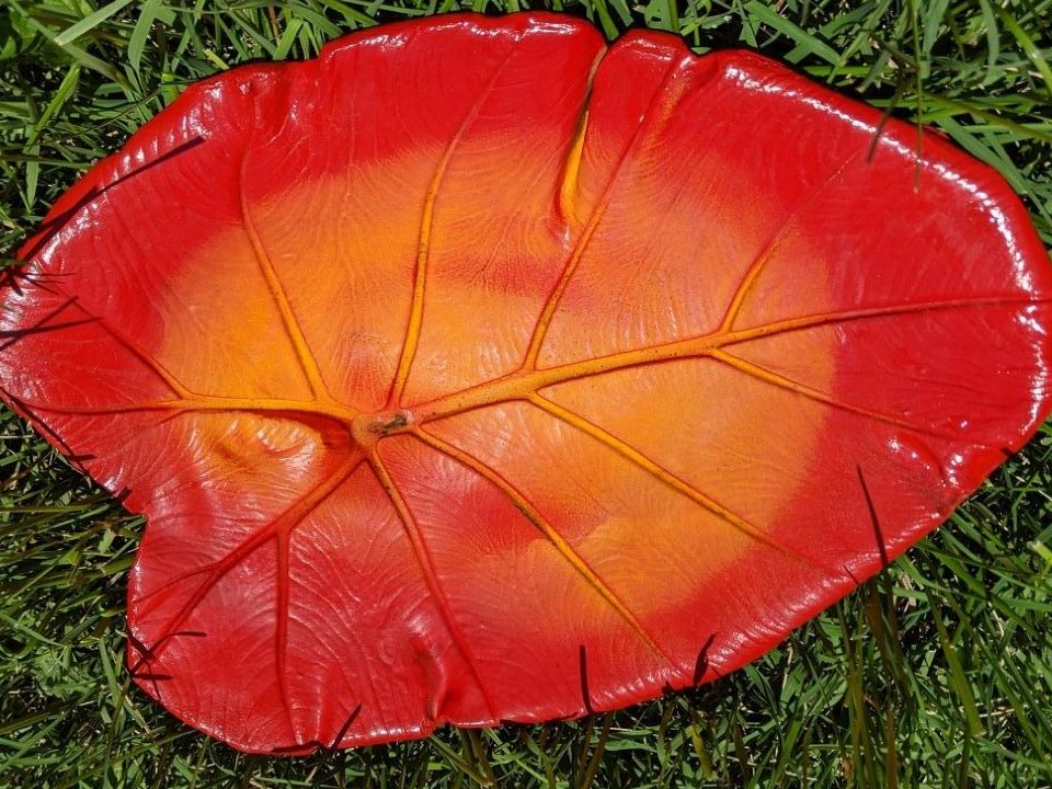 Red concrete leaf butterfly puddler art work