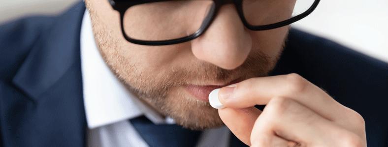 Man swallowing a pill