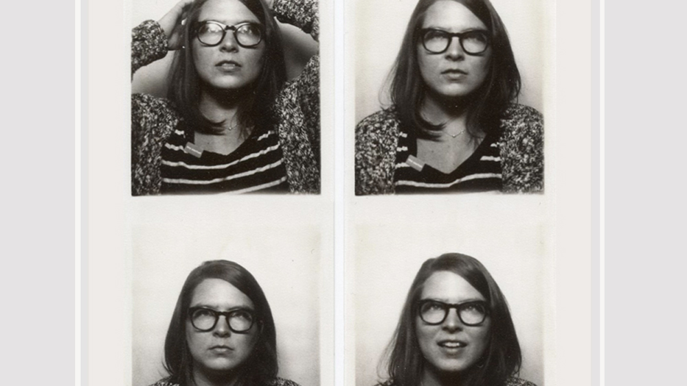 Four black and white images of Lorna in a photo booth with different expereions on her face.