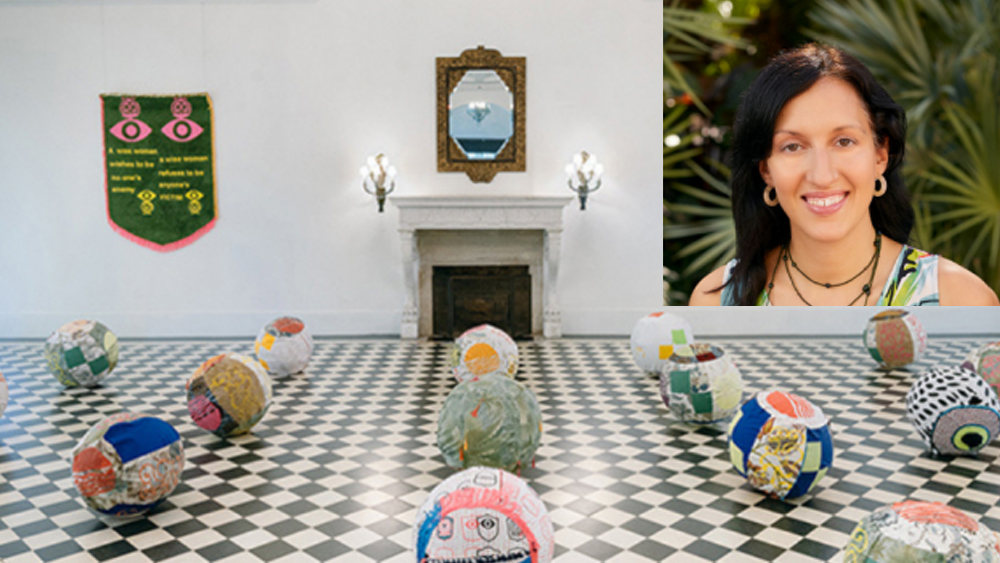 Image of colorful sewn fabric beach balls on the black and white tile florr in a formal looking room with a fireplace.  Headshot of Laura, a white woman with brown hair against tropical green leaves.