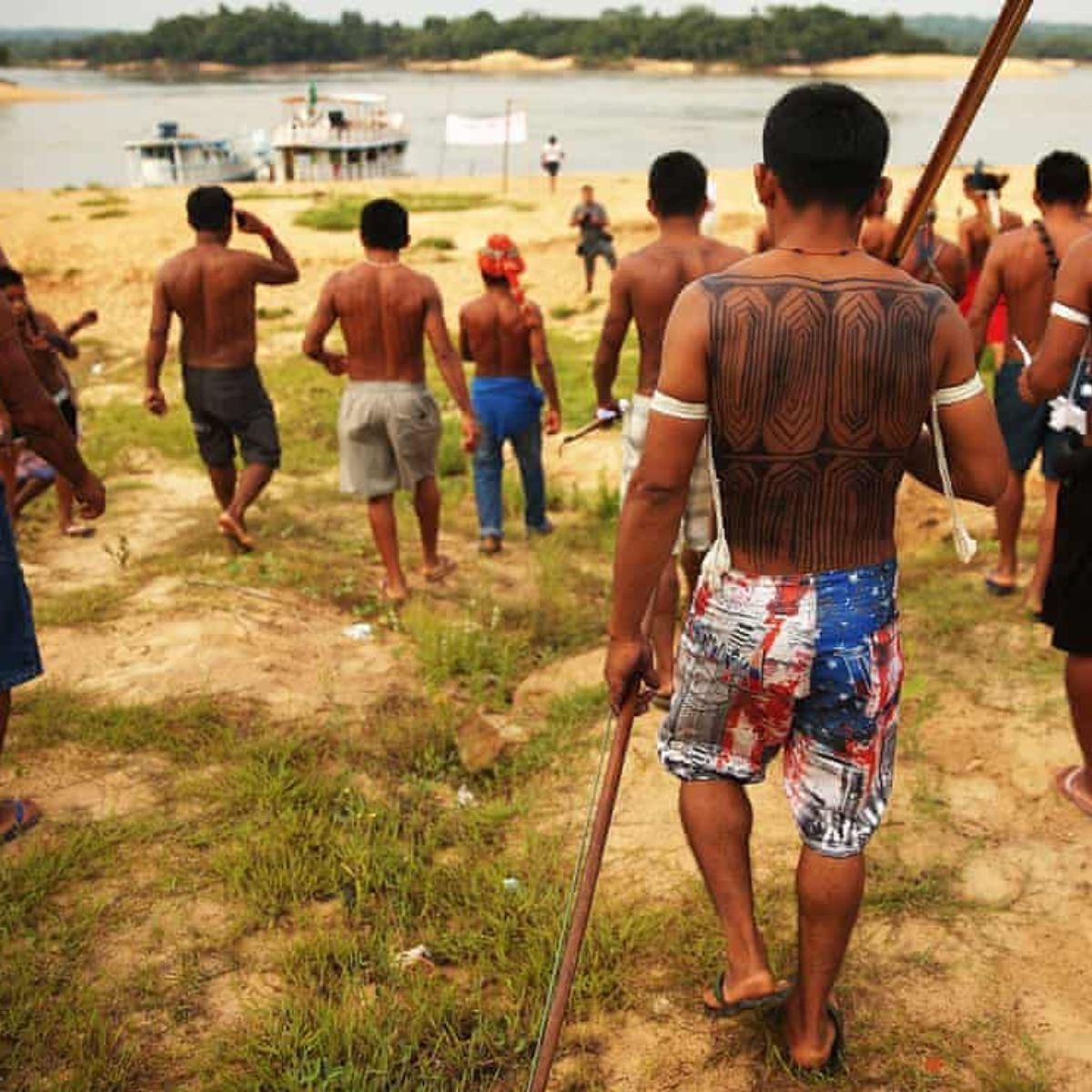 Members of the Munduruku indigenous tribe protest at the construction of a hydroelectric dam on the Tapajos River in the Amazon rainforest, 2014. Photograph: Mario Tama/Getty Images
