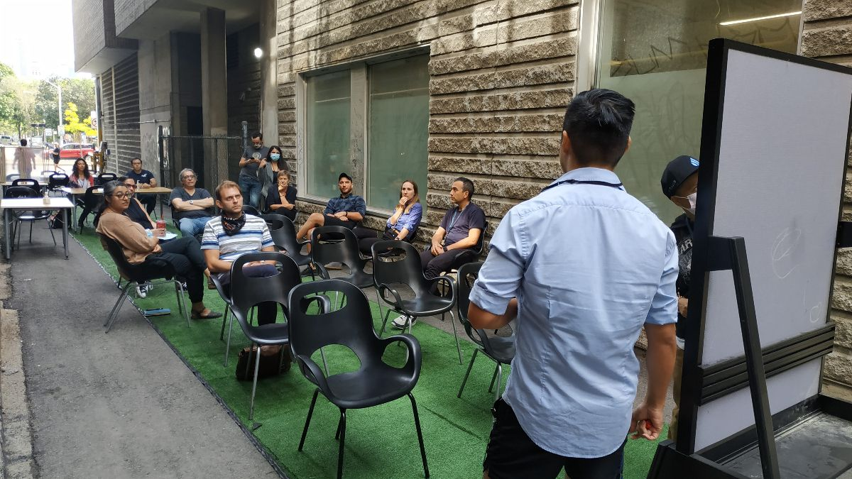 Members at CSI Spadina gather for a community engagement session during Pop-up Laneway Coworking.