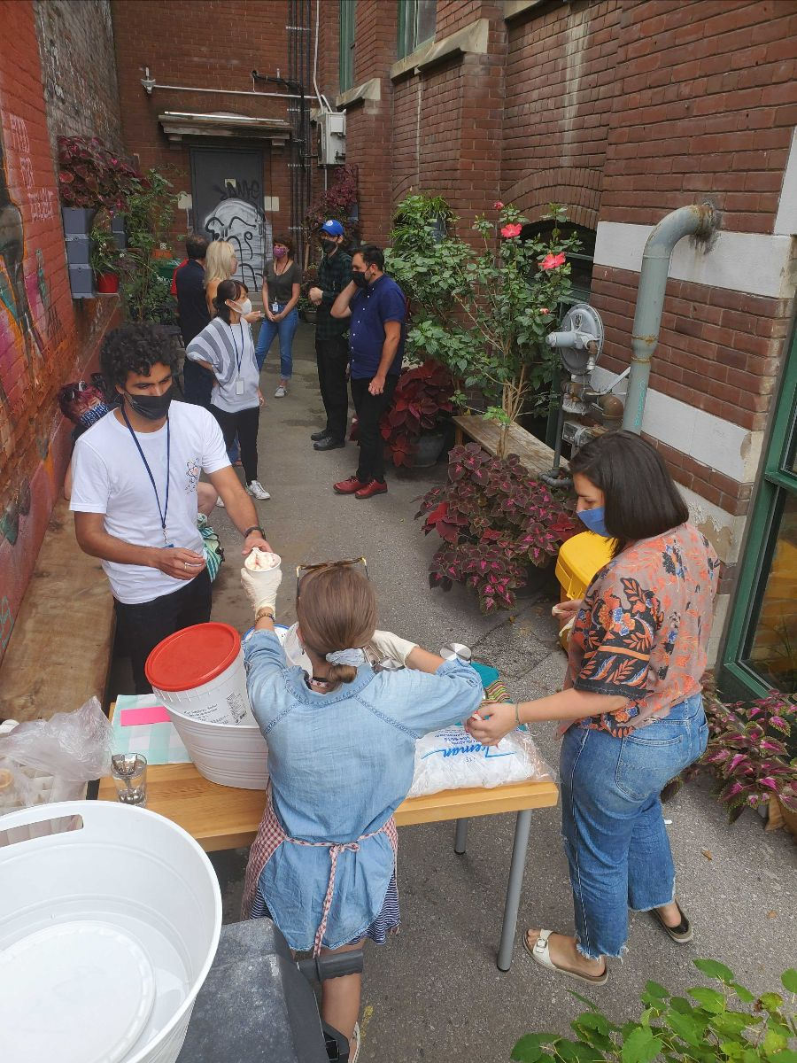 CSI Members lining up for ice cream at CSI Annex's garden patio.
