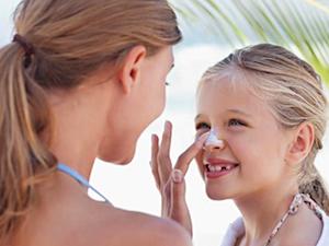 Sunscreen application on child