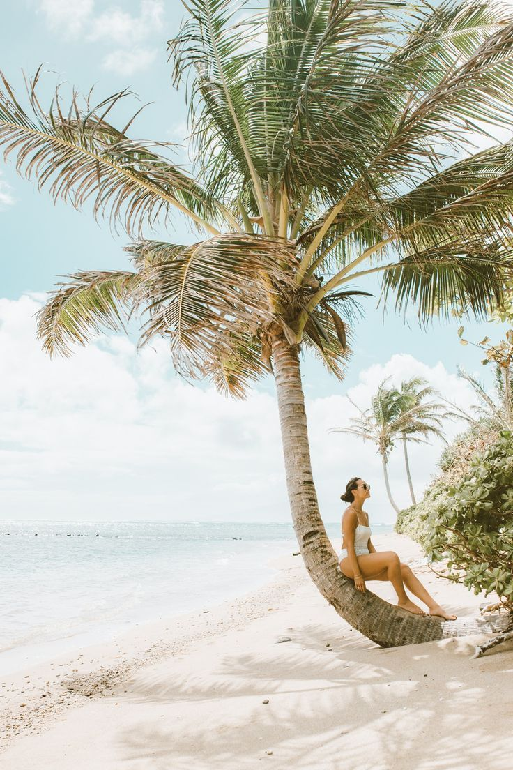 woman by palm tree