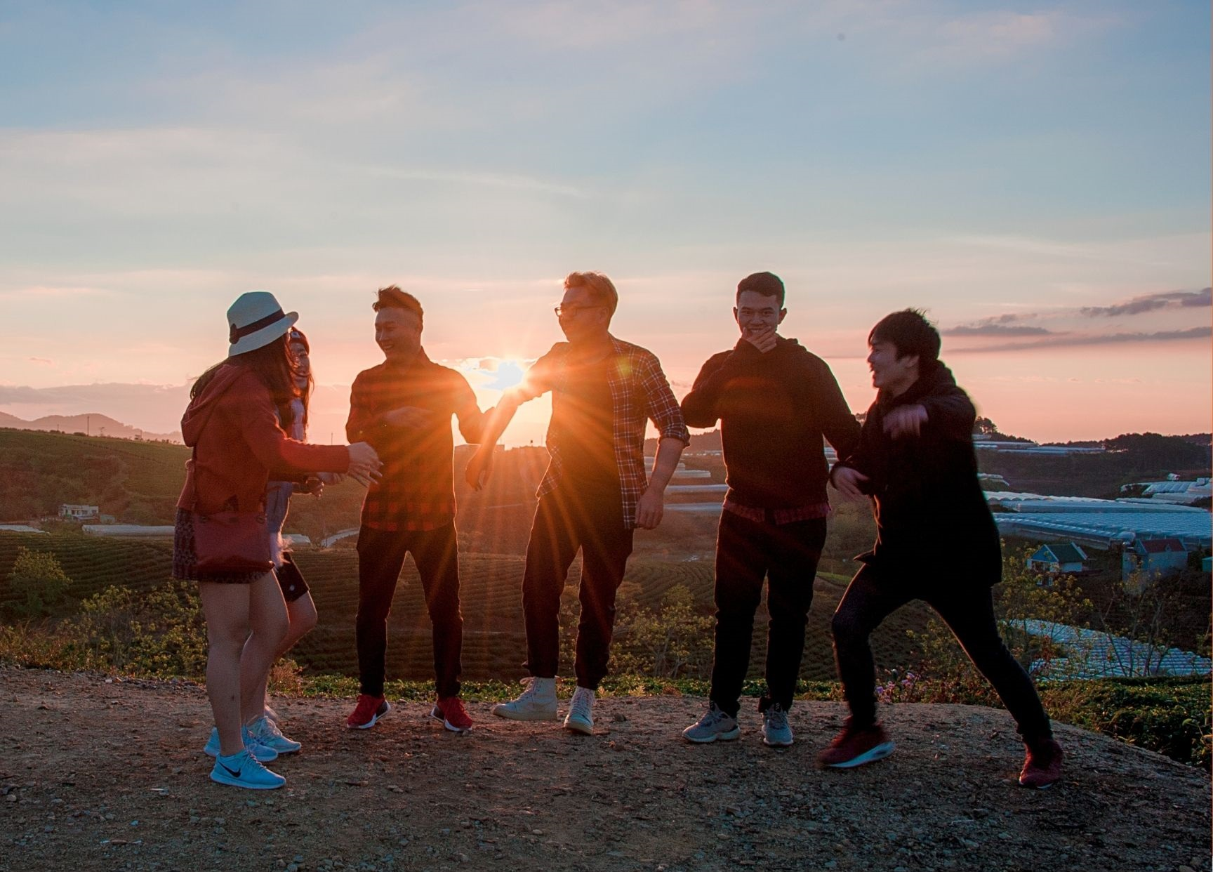A group of teens at sunset