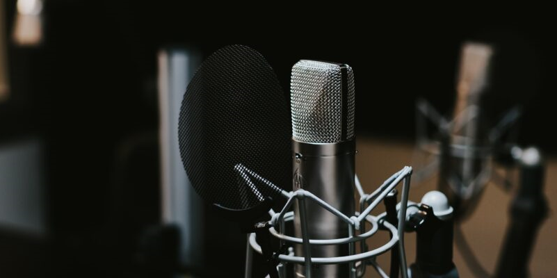 Photo of a mic and sound equipment