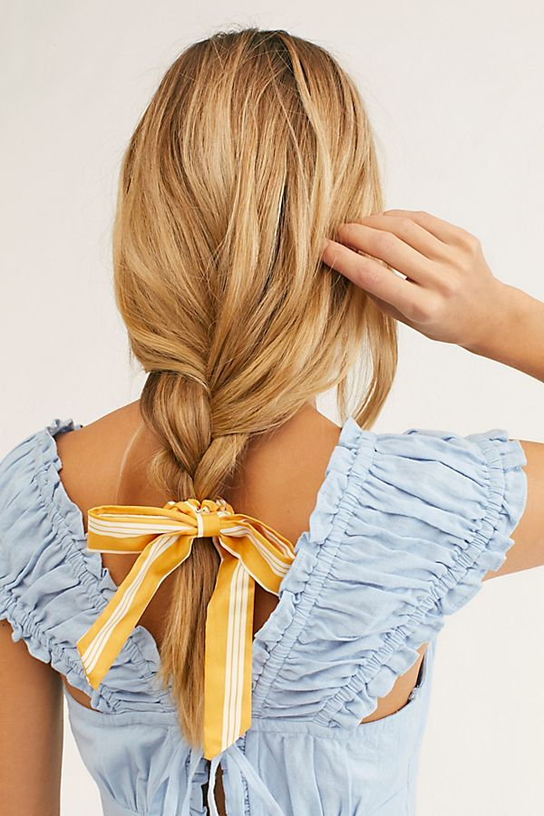 Bleached blonde long hair extensions for woman