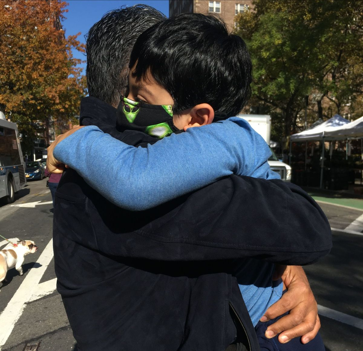 NFG President Adriana Rocha's husband, Ivan, holding their son, Emiliano, as they celebrated in the streets of Brooklyn after the 2020 elections