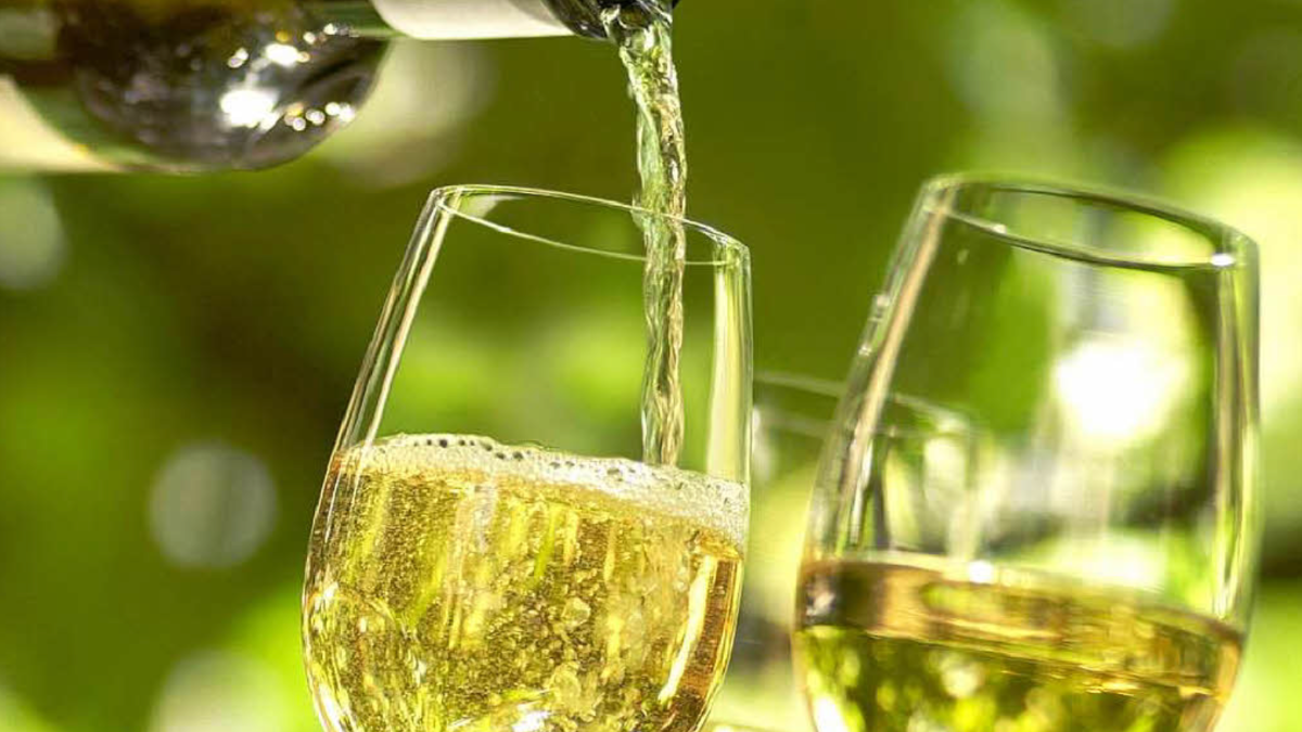 white wine pouring in glasses