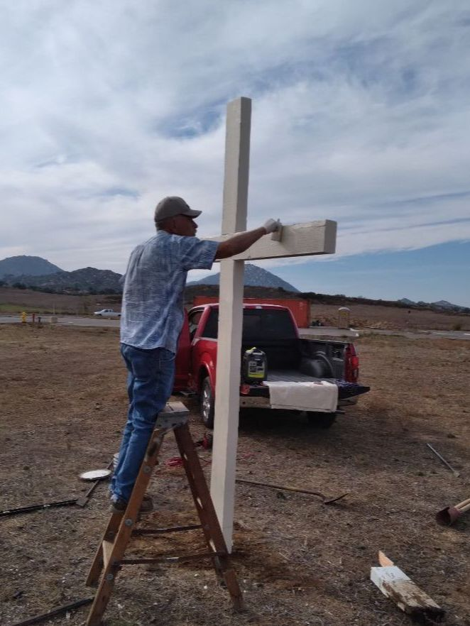 Dave, replacing the cross on the land