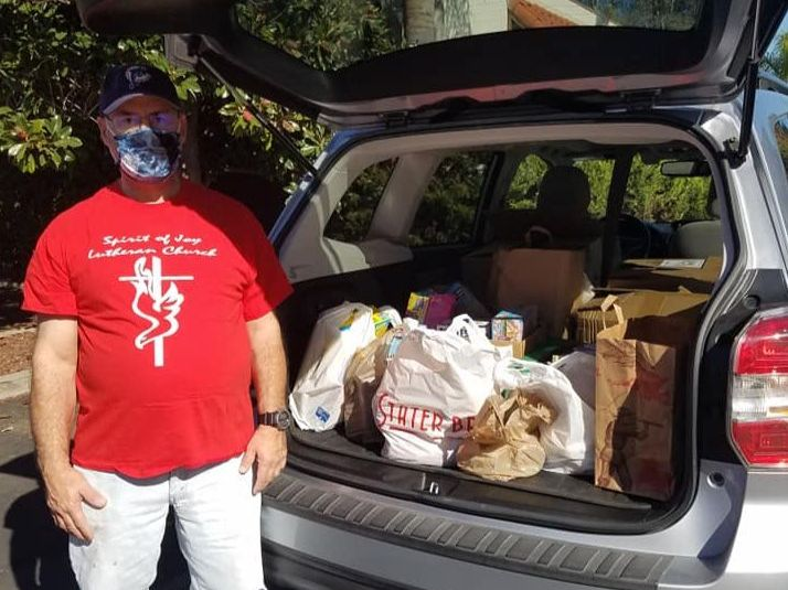 Christy & Will delivering MORE food to Ramona Food and Clothes Closet