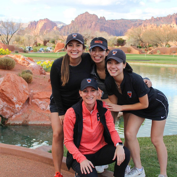 Four student athletes smiling