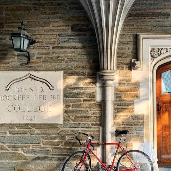 Red bike outside of Rockefeller College