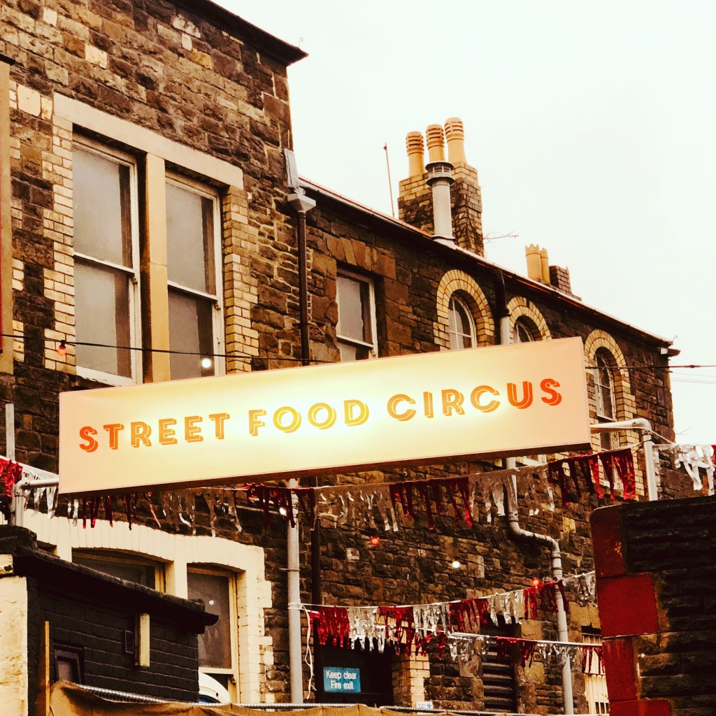 Street Food Circus signage at a street festival in Canton Cardiff