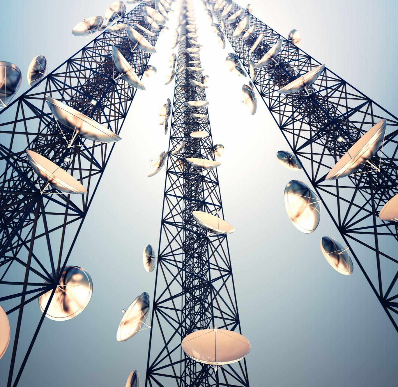 Photo of a tower with many antennas listening