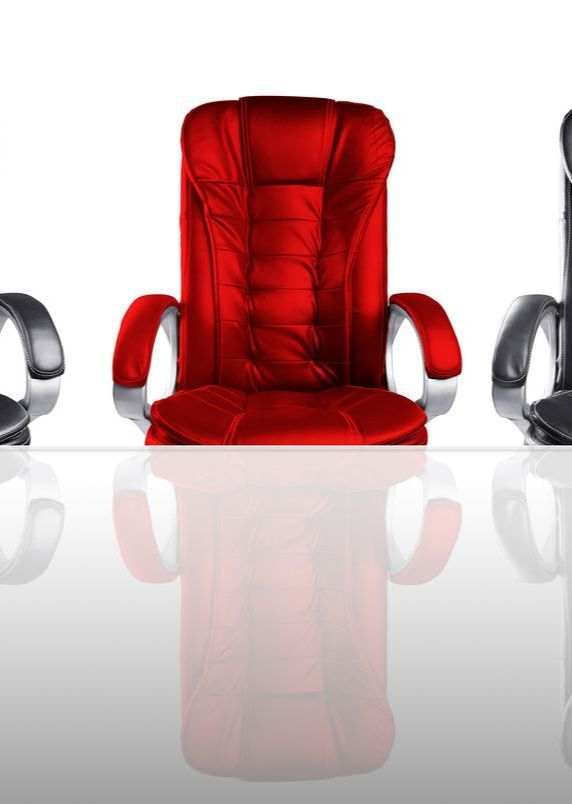 photo of a red board chair amongst black chairs