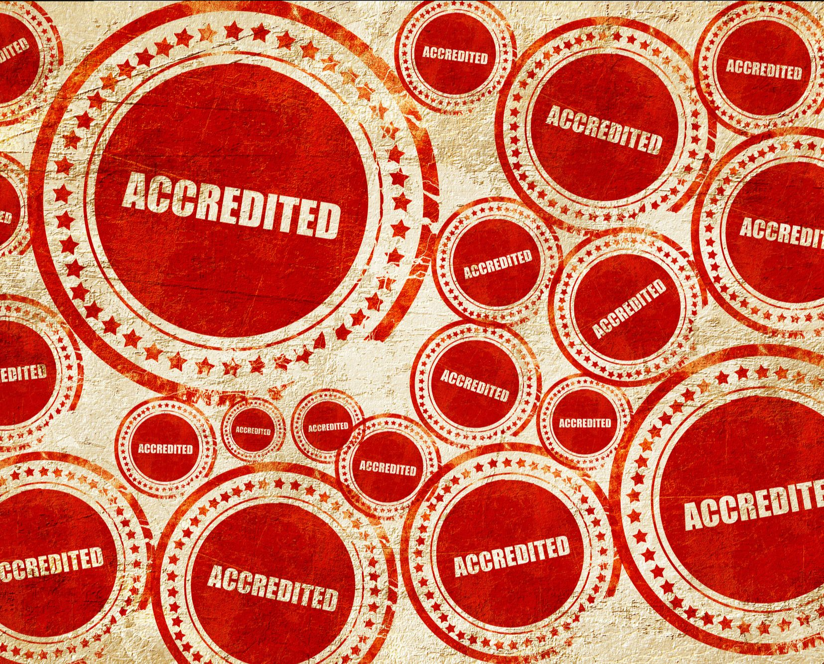 "Graphic of a field of stamps saying ""accreditation"""
