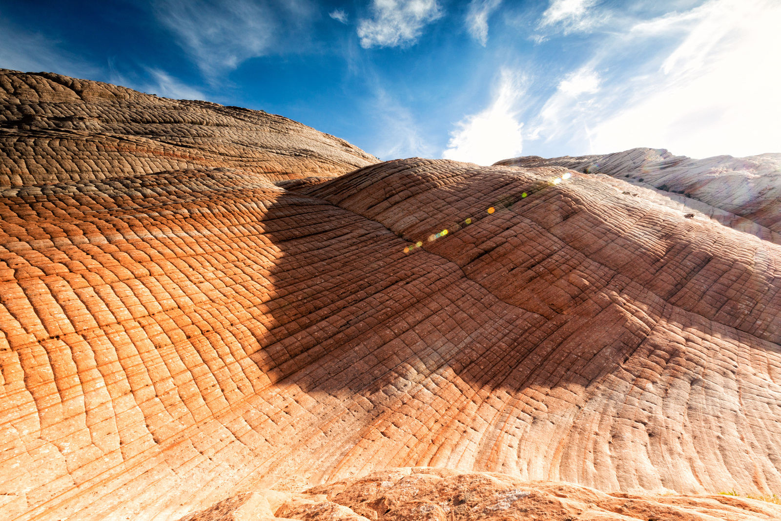 Light and shadow on the colorful sandstone formations of Yant Flat, Utah.