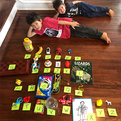 Two young boys with an alphabet of items