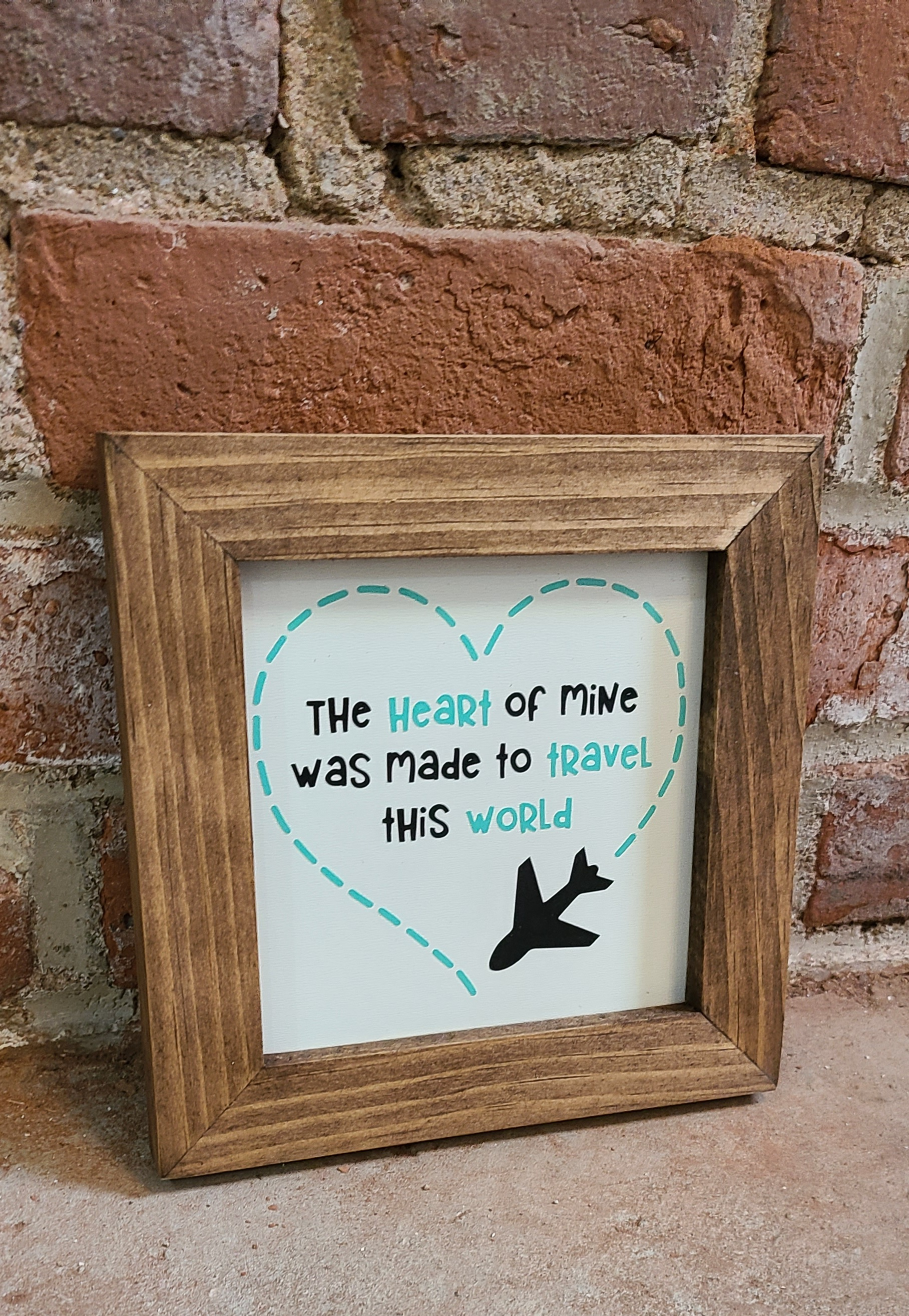The heart of mine was made to travel this world decorative sign