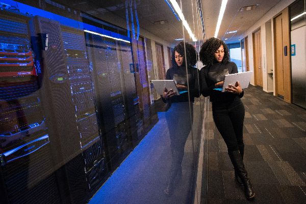 woman monitoring a server room