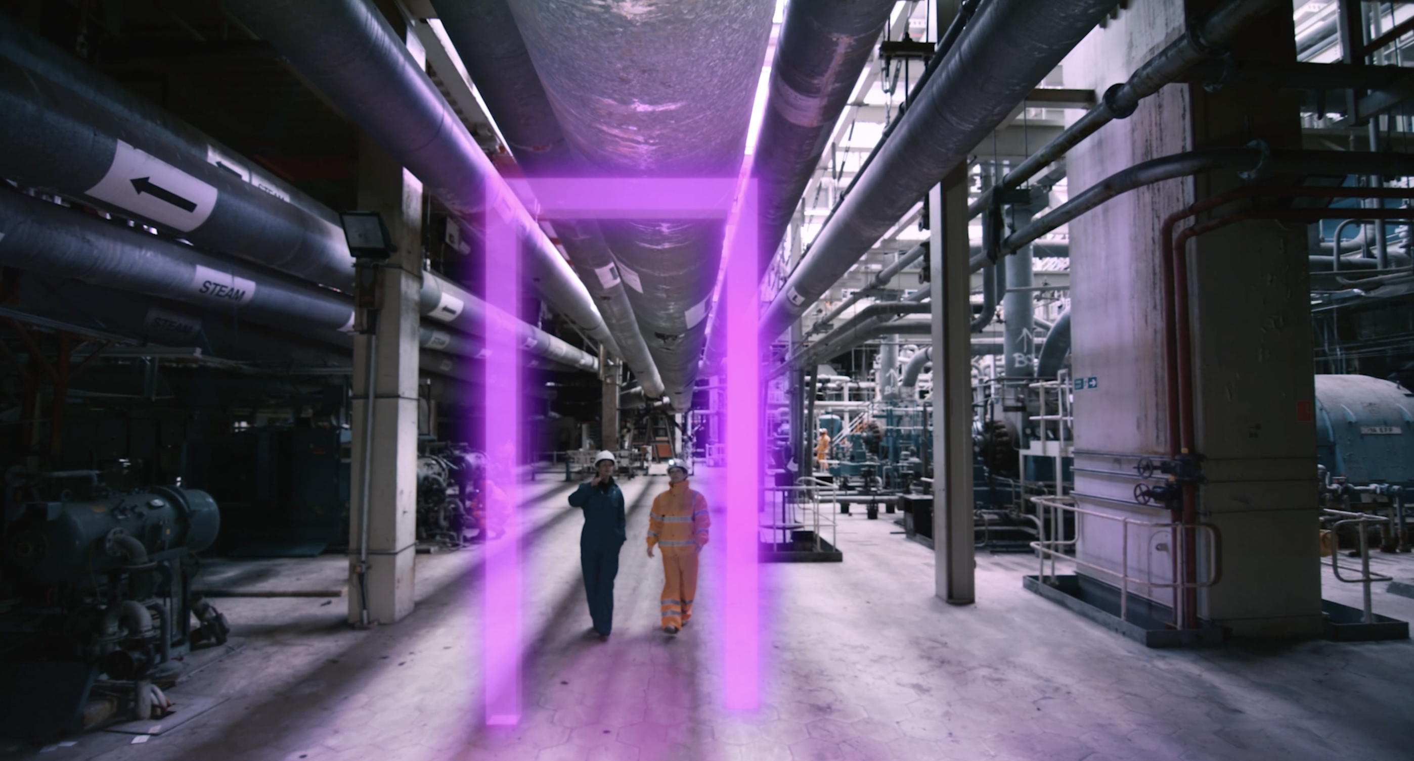Oil and gas workers walking through glowing gateway
