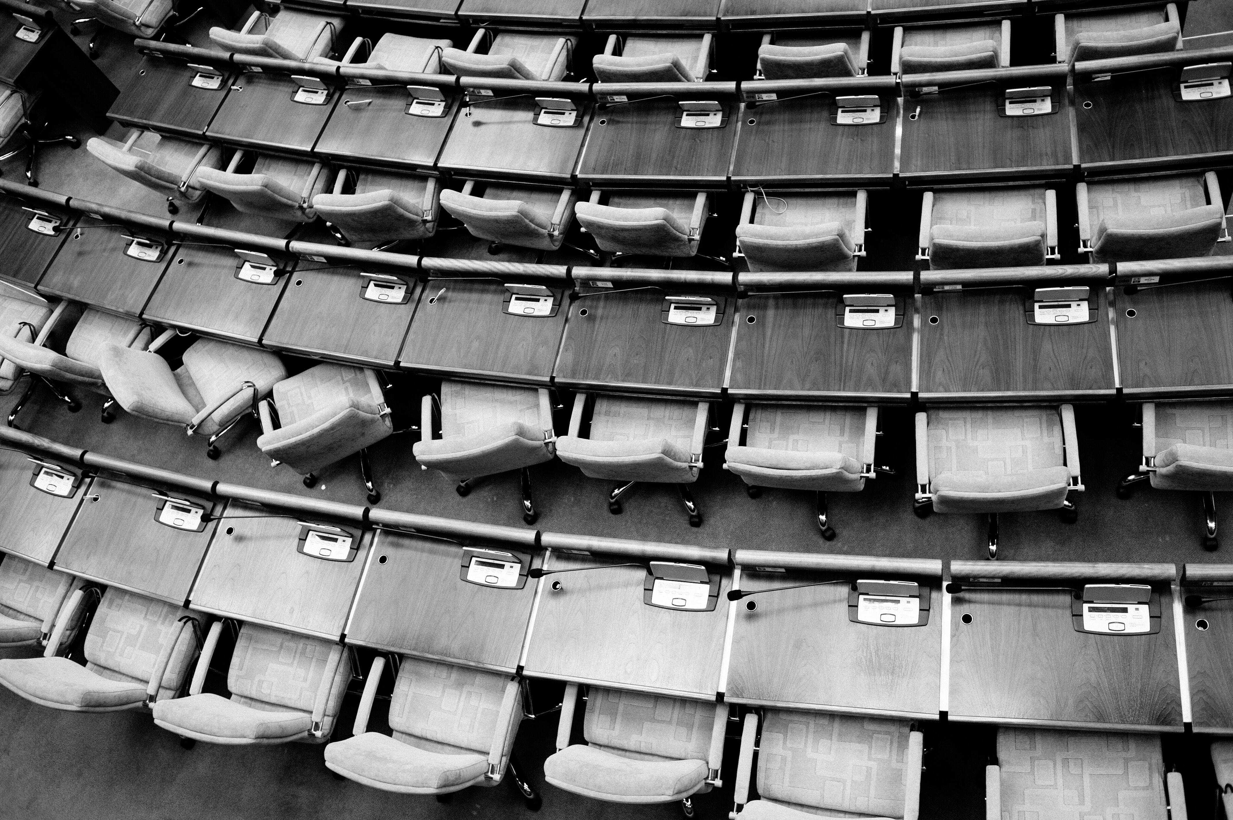 black-and-white aerial view of desks and chairs