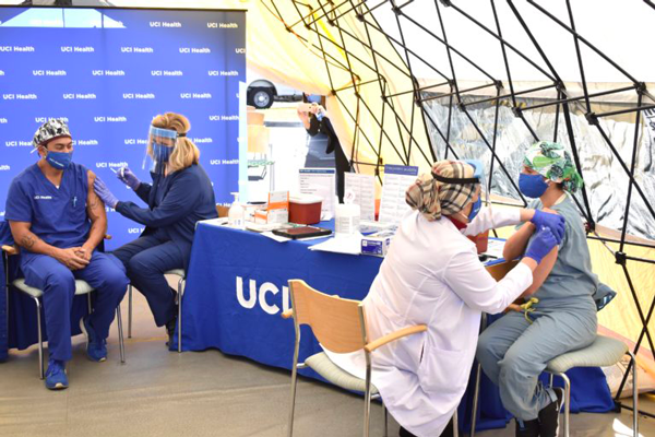 The first UCI Health frontline healthcare workers receive the vaccine Wednesday, Dec. 16. They will receive a second shot in three weeks. Carlos Puma for UCI Health