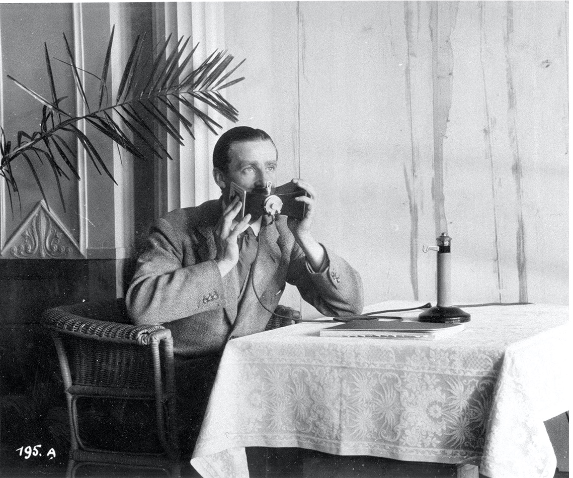 Gordon-Finlay demonstrating the Hush-a-phone(Photo: ILO Historical Archives)