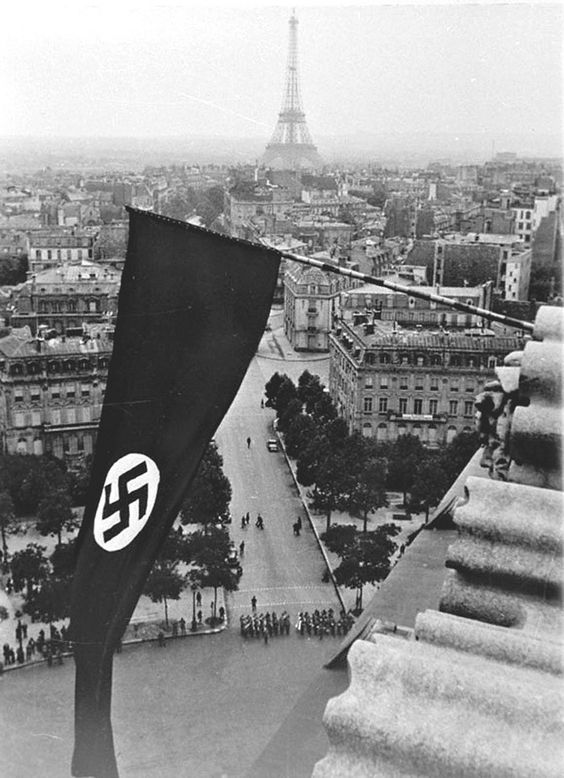 The Nazi flag flying over the Arc de Triomphe with the Eiffel Tower in the background(Photo: Everett Collection)