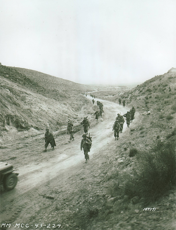 Men from the 1st Division crossing Kasserine Pass after Rommel's withdrawal, February 26, 1943(Photo: liberationtrilogy.com)