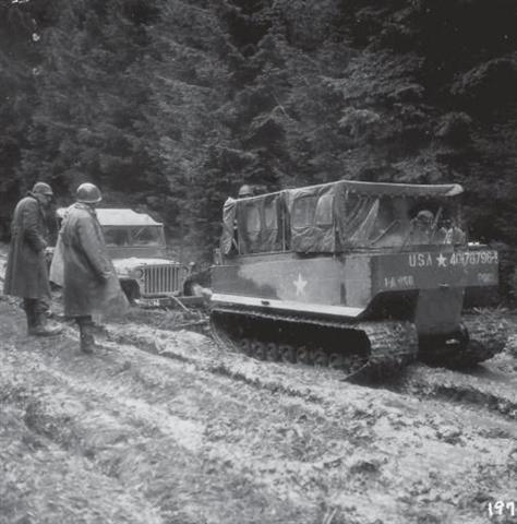 An M29 Weasel freeing a jeep from the mud in the Hürtgen Forest (Photo: U.S. Army)