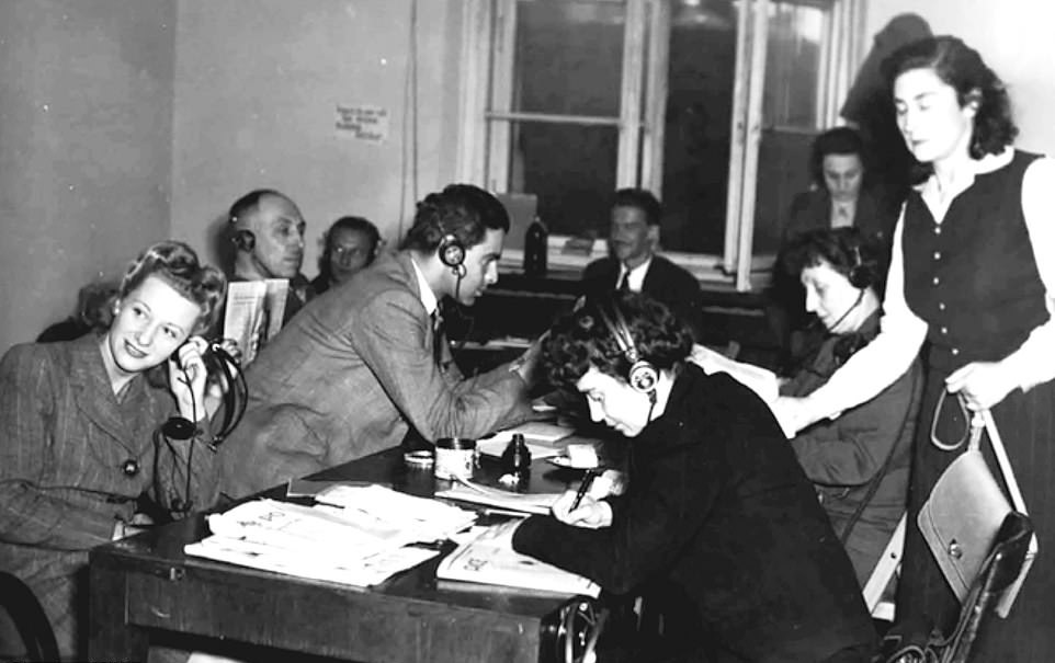 Interpreters listening to proceedings and taking notes while waiting for their shift. The man at the table is Wolfe Frank, who would translate the sentences for the defendants.(Photo: Pen&Sword/BNPS)