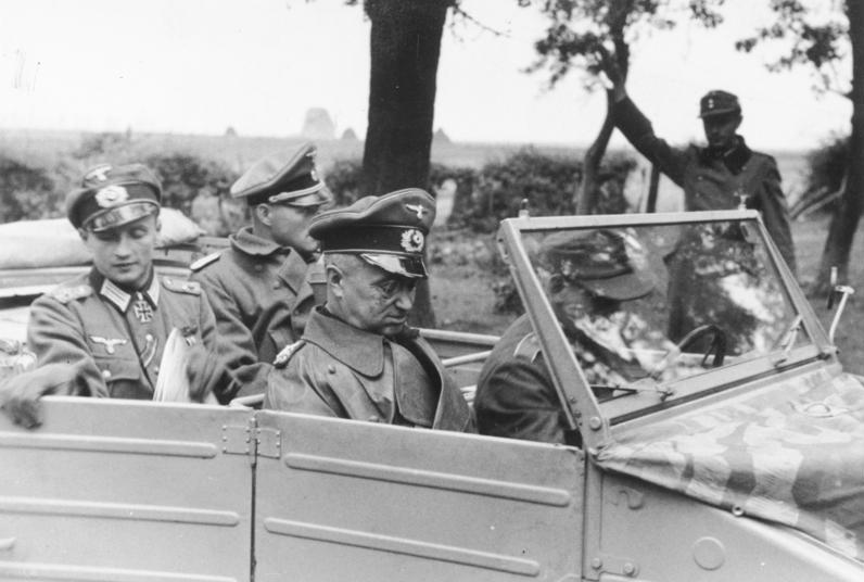 Model (third from left) near Aachen a few days before the Battle of Hürtgen Forest began (Photo: Bundesarchiv)