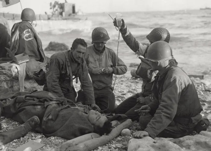 A wounded man receiving blood transfusion on Omaha on D-Day(Photo: history.com)
