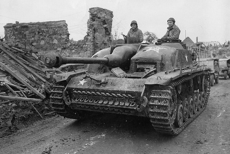 Two of the Timberwolves in a StuG III captured during the Battle of the Bulge. Note the white star painted on to avoid friendly fire from aircraft, and the StG 44 in the left soldier's hands. (Photo: U.S. Army)