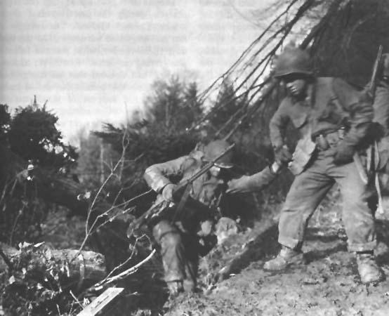 U.S. soldiers climbing up a hillside in the Hürtgen Forest (Photo: U.S. Army)