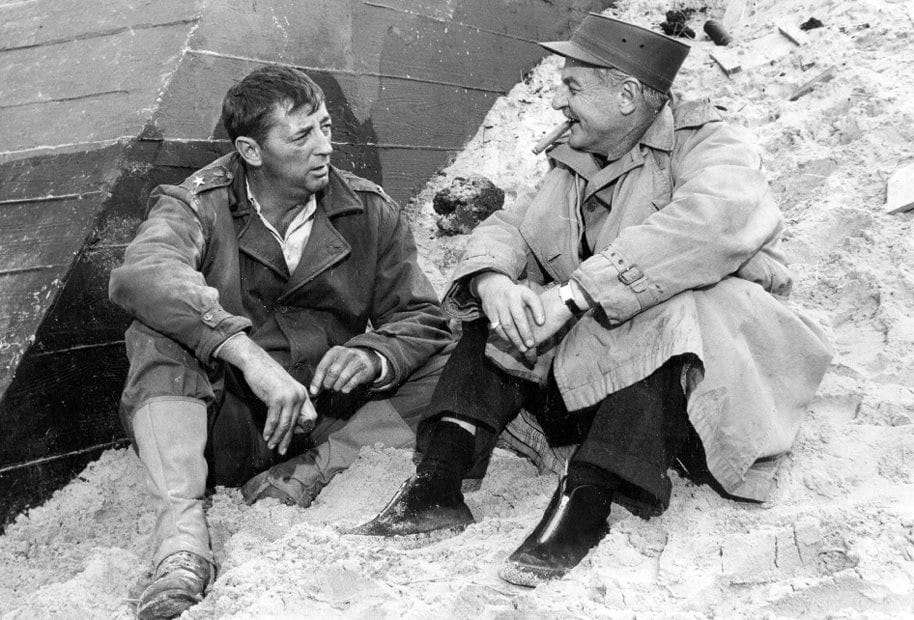 Robert Mitchum (left) with producer Darryl F. Zanuck, who also played an uncredited role in The Longest Day(Photo: IMDB)