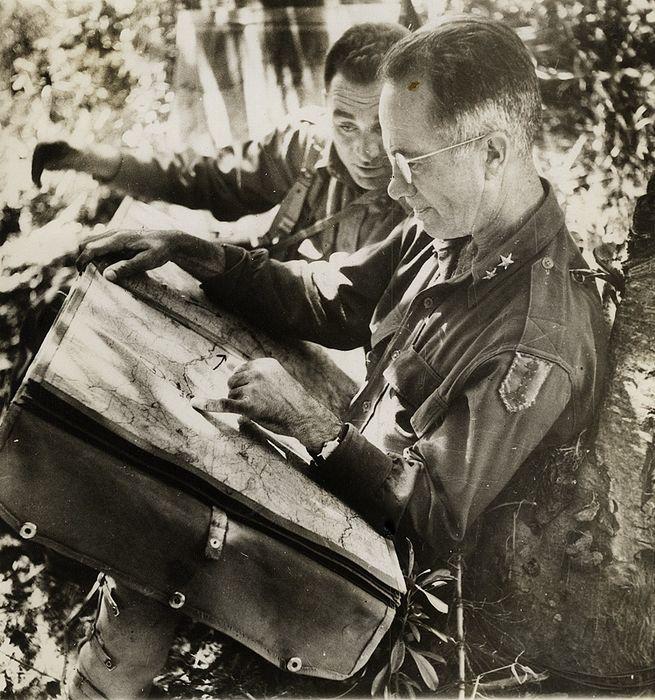 Allen studying a map in Sicily(Photo: Robert Capa)
