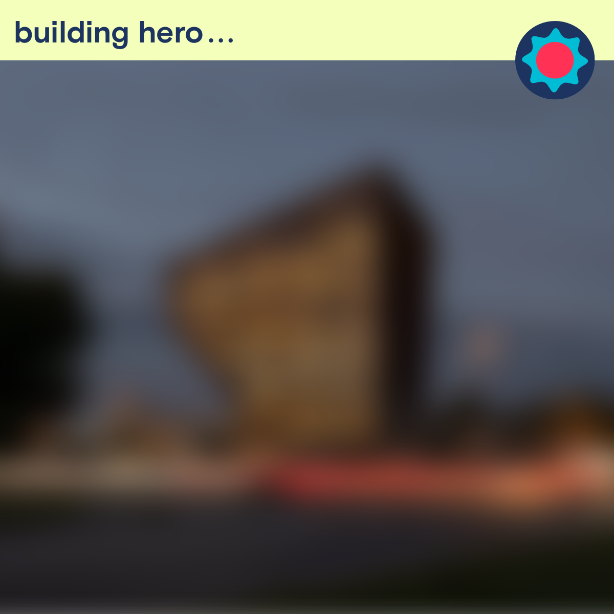 Building hero: click to reveal