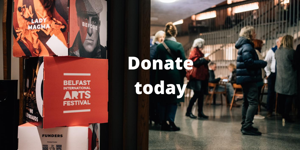Donate today. Image of audience waiting in theatre foyer before a performance