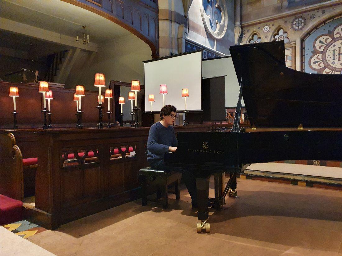 Martin James Bartlett playing piano in St Mark's Church Belfast