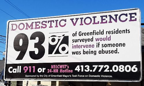 """Billboard that says: """"Domestic Violence: 93% of Greenfield residents surveyed would intervent if someone was being abused. Call 911 or NELCWIT's 24-hr hotline, 413-772-0806. Sponsored by the City of Greenfield Mayor's Task Force on Domestic Violence."""""""