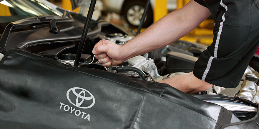 Toyota Mechanic Servicing a Vehicle at Downtown Toyota