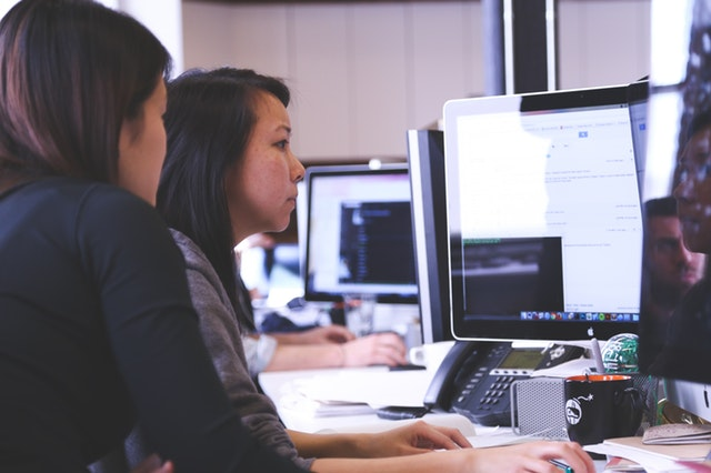 Two women sitting at a computer