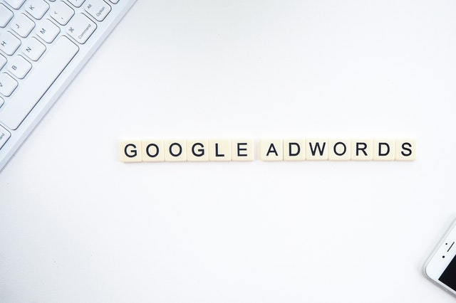 Google Adwords spelled out in scrabble tiles