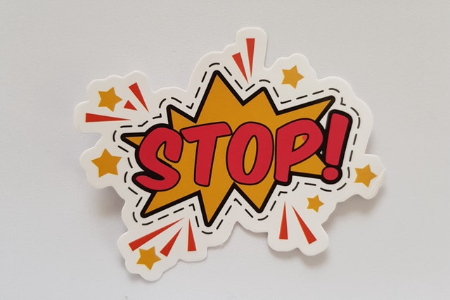 A cut out of a comic book graphic that says Stop